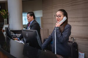 Hotel Receptionist is answering the phone
